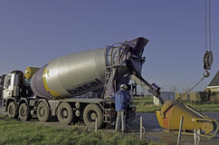 Concrete truck pouring Stock Photography