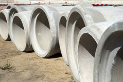 Concrete tubes. Some concrete tubes in the ground. Construction concept stock photos
