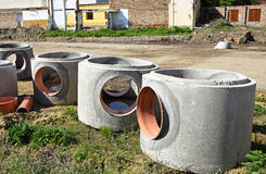Concrete tubes at the road construction Stock Photos