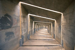 Concrete tunnel. A gloomy concrete tunnel, can be used as a concept regarding depression and destress Royalty Free Stock Image