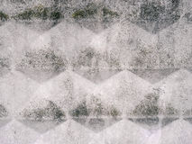 Concrete urban texture with a pattern of rhombuses and surface roughness. Grunge gray urban background Royalty Free Stock Photo