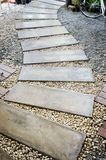 Concrete walkway in garden Stock Image
