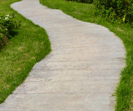 Concrete walkway and grass Royalty Free Stock Image