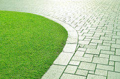Concrete walkway and grass. Royalty Free Stock Photography