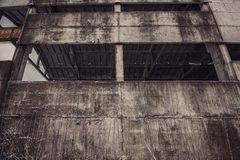 Concrete wall of abandoned ghost factory. Abandoned industrial building wall Stock Photography