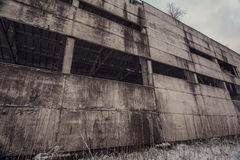 Concrete wall of abandoned ghost factory Royalty Free Stock Photos