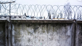 Concrete wall, against the backdrop of barbed wire, the concept Royalty Free Stock Photography