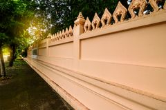 The concrete wall around the Buddhist temple. royalty free stock photo