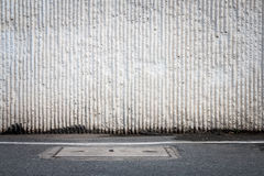 Concrete wall and asphaltic road Royalty Free Stock Photo
