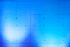 Concrete wall with blue spotlights Royalty Free Stock Photography
