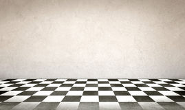 Concrete wall and checkerboard floor Stock Photography