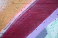 Concrete wall with colorful graffiti. Detail view of colored areas on a concrete wall stock photography