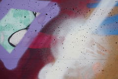 Concrete wall with colorful graffiti. Detail view of a colored concrete surface stock photos