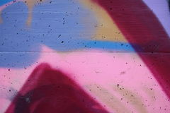 Concrete wall with colorful graffiti. Detail view of a colored concrete surface royalty free stock photography