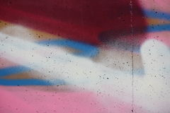 Concrete wall with colorful graffiti. Detail view of a colored concrete surface royalty free stock photo