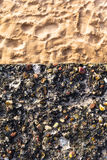 Concrete wall colorful pebbles sand Stock Photography