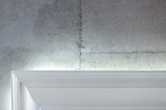 Concrete wall and cornice. Concrete wall and white cornice. Close up shot Royalty Free Stock Image
