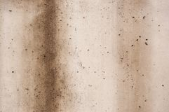 Concrete wall covered with bad weather with brown streaks Royalty Free Stock Image