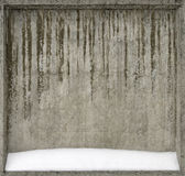 Concrete wall covered with snow. It can be used as a background for Christmas and New Year themes and more Royalty Free Stock Photos