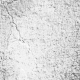 Concrete wall with cracks on the white clay coating, textured background.  stock illustration