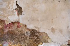 Concrete wall with damaged plaster royalty free stock images