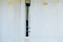 Concrete wall with door and railing under the bridge Stock Photo