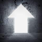 In concrete wall doorway as arrow. Bright light Royalty Free Stock Photo
