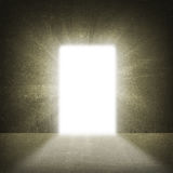 In concrete wall doorway with bright light. Business concept Stock Photography