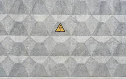 Concrete wall with electric warning sign Royalty Free Stock Image