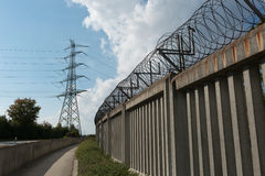 Concrete wall and electrical tower Royalty Free Stock Photos