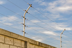 Concrete Wall with Electricty Cables Royalty Free Stock Images