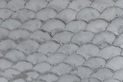 Concrete wall in fish scale shape pattern texture. Background royalty free stock photos
