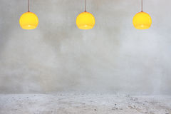 Concrete wall and floor with orange lamps Stock Photography