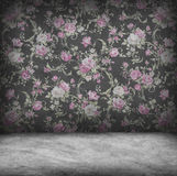 Concrete wall and floor texture with rose wallpaper. Grunge design Stock Photo