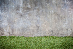 Concrete wall and green grass floor texture Royalty Free Stock Images