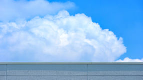 Concrete wall of high building with blurred cloud and blue sky background Stock Photography