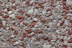 Concrete wall with lining from bits of broken brick. Used as a background. royalty free stock images