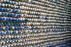 Concrete wall made of recycled plastic bottles. Bottle recycling: plastic bottles which have been set in concrete to form a bottle wall Royalty Free Stock Photos