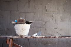 Concrete wall making and object tool. Closeup stock photography
