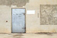 Concrete wall with metal door Stock Photos