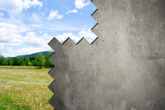 Concrete wall Between nature and city Royalty Free Stock Photos