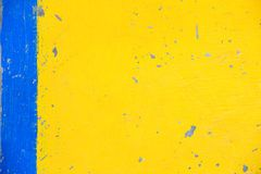 Concrete Wall Painted In Colors Of Yellow And Blue. Royalty Free Stock Images