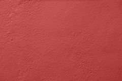 Concrete wall painted with a red paint stock images