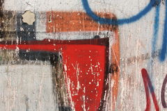 Concrete wall with peeling graffiti. Close-up view of a colorful peeling graffiti on a concrete surface stock photos