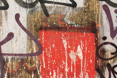 Concrete wall with peeling graffiti. Close-up view of a colorful peeling graffiti on a concrete surface stock photo