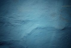 Concrete wall with plaster texture. Blue concrete wall with plaster texture stock image