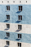 Concrete wall of residential urban high-rise building. With windows illuminated by sun Stock Image