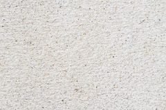 Concrete wall sand and stone grunge style texture background. Closeup concrete wall sand and stone royalty free stock photos