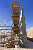 Concrete wall and scaffolding Stock Images