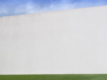 Concrete wall with sky and lawn Stock Photography